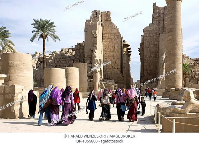 Great Court and Second Pylon, female visitors wearing traditional clothing, Temple of Amun-Re, Karnak Temple, Luxor, Egypt, Africa