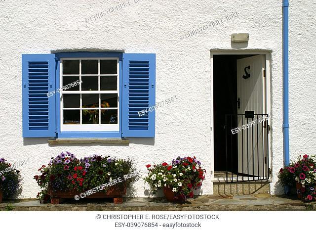 England, Cornwall, St Mawes, Blue and white cornish seaside cottage