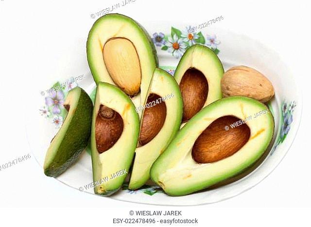 Fresh Avocado Halves On Plate