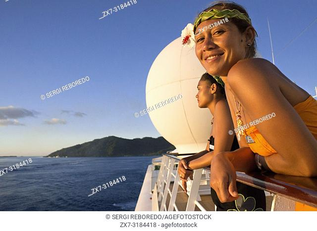 Nice girls at the dock of Paul Gauguin cruise, Society Islands, Tuamotus Archipelago, French Polynesia, South Pacific