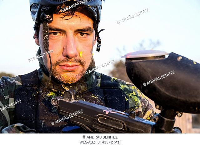 Portrait of a paintball player