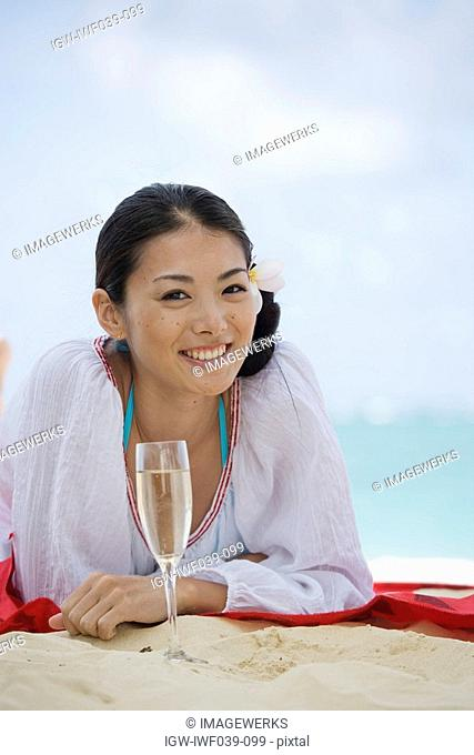 Portrait of a young woman smiling at beach