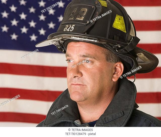Male firefighter in front of American flag
