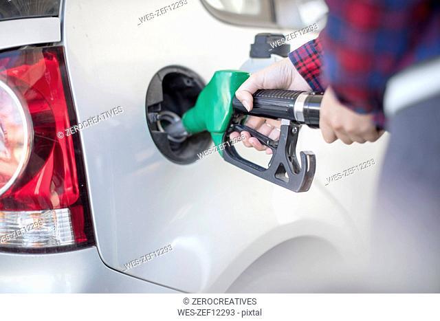 Woman fueling car