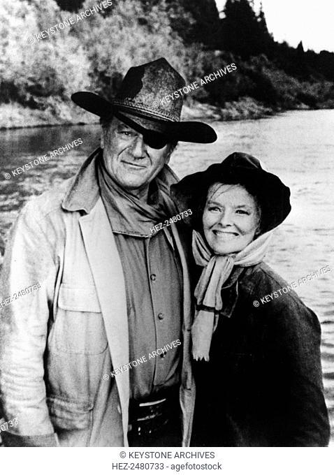 American actors John Wayne and Katharine Hepburn in 'Rooster Cogburn', 1975. Wayne (1907-1979) and Hepburn (1907-2003) starred in Stuart Millar's western