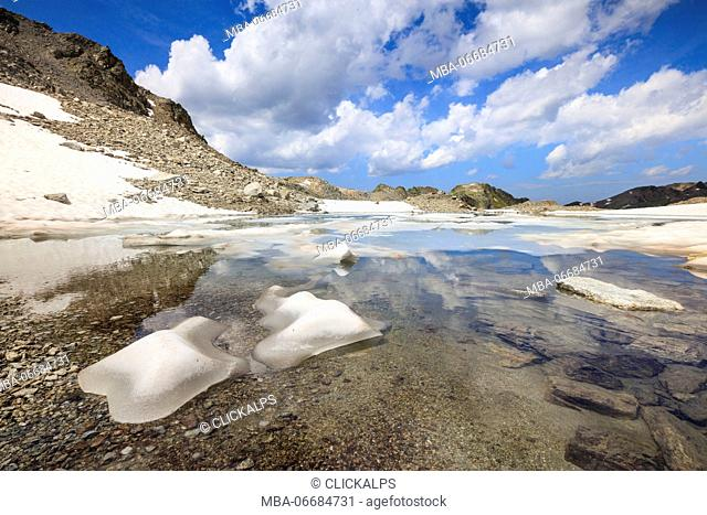 Ice and snow during summer thaw of the alpine lake Joriseen Jörifless Pass canton of Graubünden Engadin Switzerland Europe