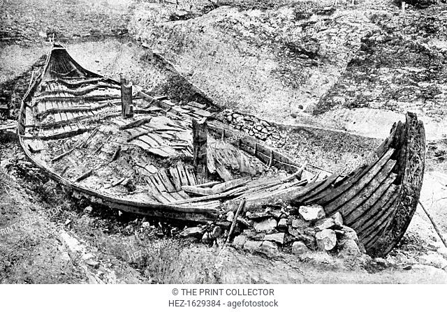 Stern view of the Oseberg Viking ship after months of excavation, Norway, c1904-1905. The oak ship, which was found in a large burial mound