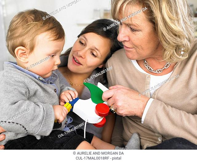 grandmother, mother and baby boy