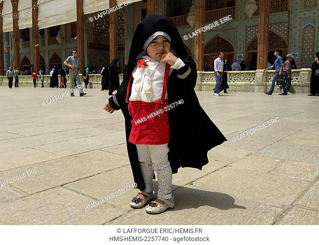 Iran, Fars Province, Shiraz, little girl at the shah-e-cheragh mausoleum