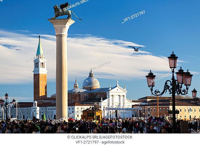 St Mark's Square and San Giorgio Maggiore during Venice Carnival. Venice, Veneto, Italy