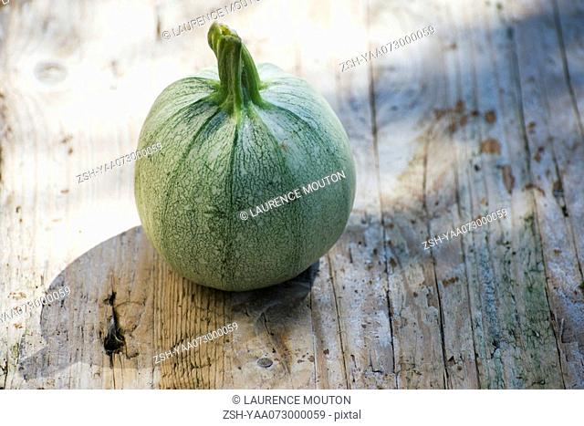 Squash on wooden background