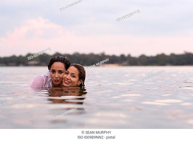 Clothed friends in water, Destin, Florida, United States, North America