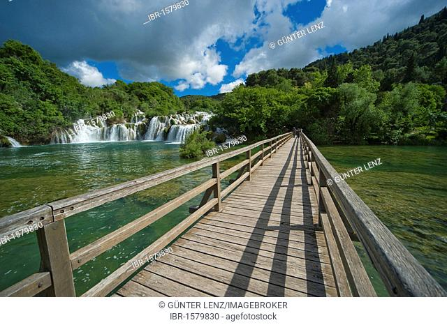 Wooden bridge and waterfalls in Krka National Park, aeibenik-Knin County, Croatia, Europe