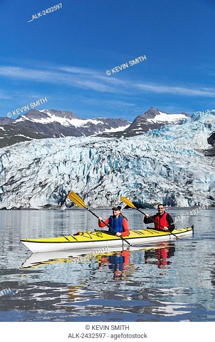 Couple sea kayaking at Shoup Bay State Marine Park, Prince William Sound, Valdez, Southcentral Alaska
