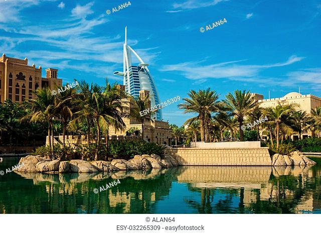 DUBAI, UAE - NOVEMBER 15: View of the hotel Burj Al Arab from Souk Madinat Jumeirah. Nov 15, 2012 in Dubai. Burj Al Arab is a luxury 7 stars hotel built in...