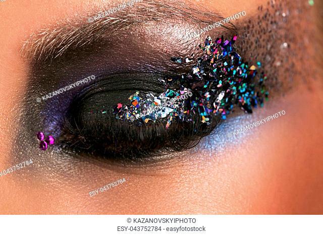 Model's eye with makeup and colorful crystals, girl's eye, eyeshadow and colorful crystals, perfect make up, model, big eyes, long eyelashes