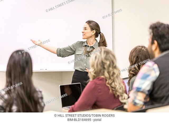 Professor addressing college students in class