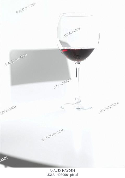 Wineglass on white table