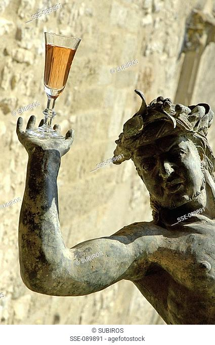 statue holding glass of rosé topic: rosé wine