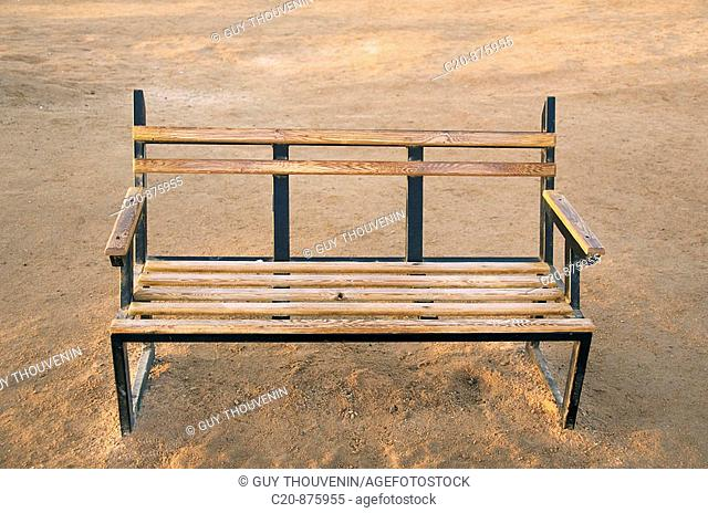 Wooden and metal bench on beach, Egypt