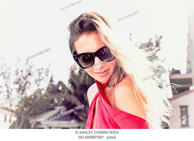 Fashionable young woman in sun
