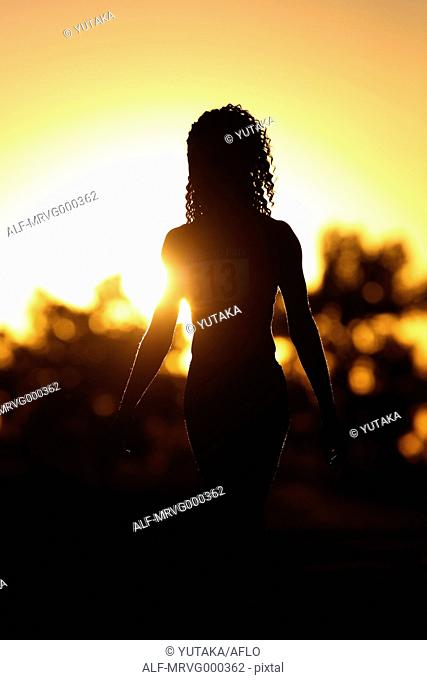 Running female athlete silhouette