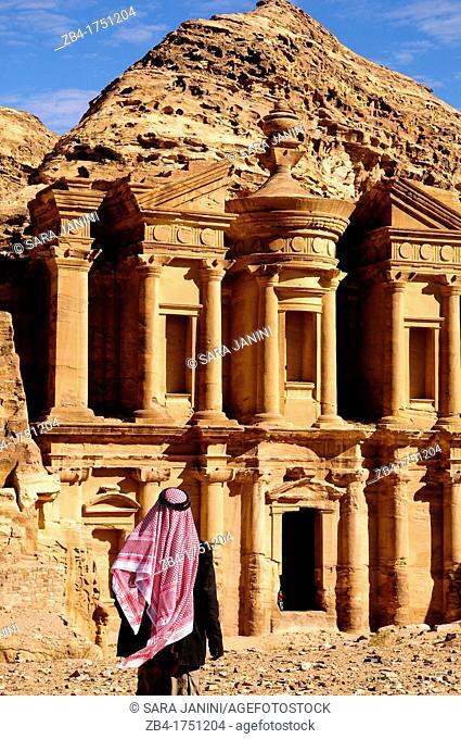 A beduin man looking at Al Deir Ad-Deir, the Monastery, Archaeological site, UNESCO World Heritage Site, Petra, Jordan, Middle East
