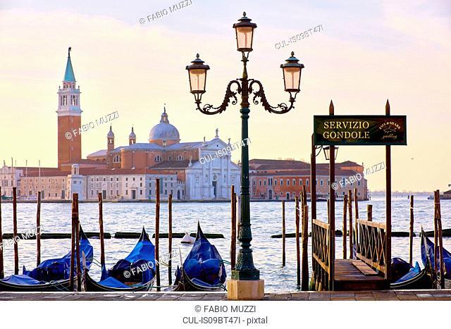Gondolas on St Marks square waterfront with San Giorgio Maggiore church in background, Venice, Veneto, Italy
