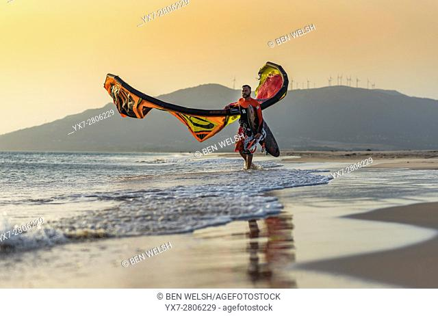 Man with his kitesurf equipment. Tarifa, Costa de la Luz, Cadiz, Andalusia, Spain