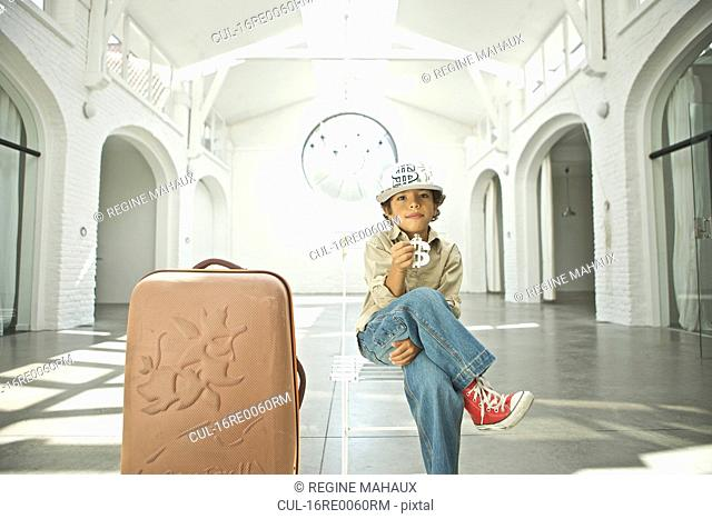 child with his suitcase