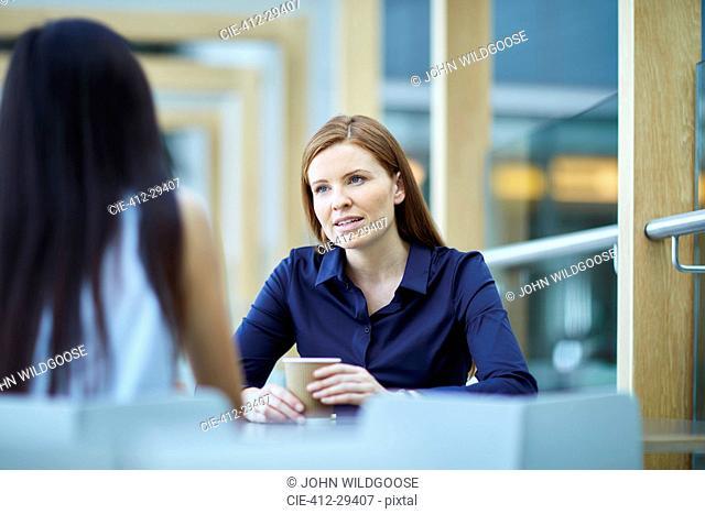 Businesswomen talking on coffee break