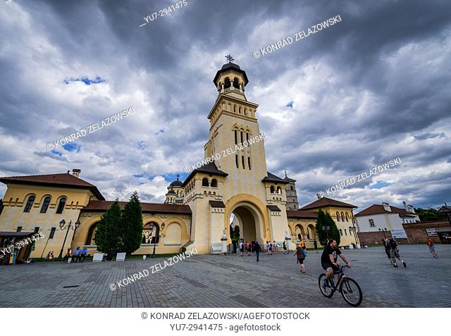 Bell tower and entry to Coronation Cathedral of Holy Trinity and Archangels Michael and Gabriel in Alba Carolina Fortress of Alba Iulia city, Romania