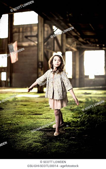 Young Girl Dancing in Abandoned Warehouse