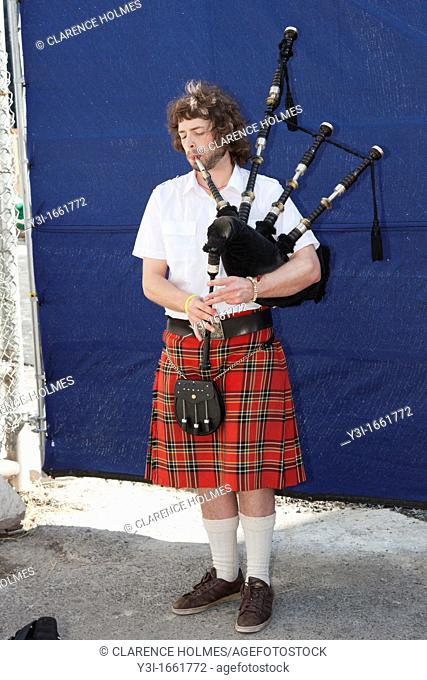 A man plays a bagpipe near the World Trade Center construction site in New York City, New York, USA