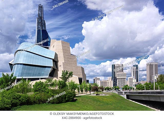 Canadian Museum for Human Rights and downtown skyline under beautiful cloudy sky on a summer day in Winnipeg, Manitoba, Canada 2017