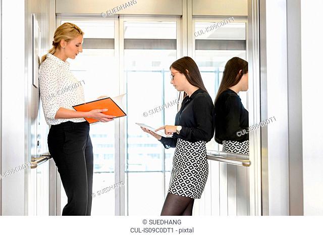 Colleagues having discussion at corridor