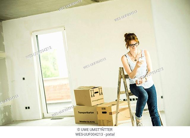 Young woman having a break form renovating
