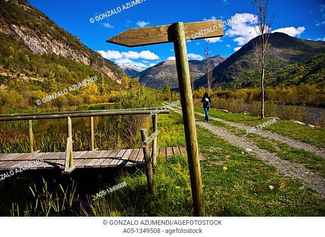 Woman  Hiking  Information sign  Camí de l'Aigua  Barruera. Boi-Taull Valley, Alta Ribagorça Region, Peripheric area, Aigüestortes i Estany de Sant Maurici...