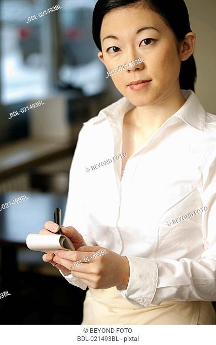 portrait of japanese waitress taking an order