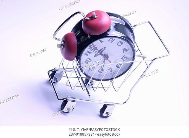 Alarm clock in shopping trolley