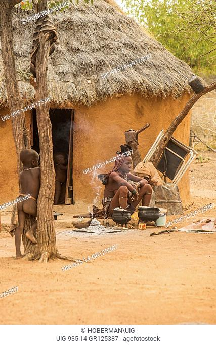 Himba Woman With Braided Hair And scented Red Body