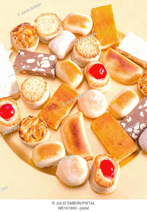 Typical sweet Christmas marzipan in golden tray