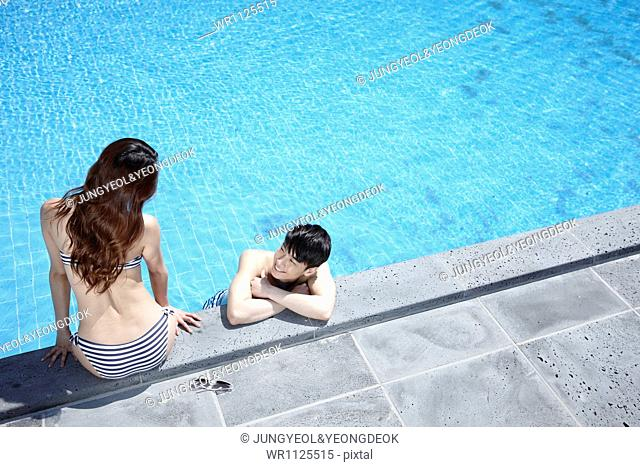 a couple in the pool