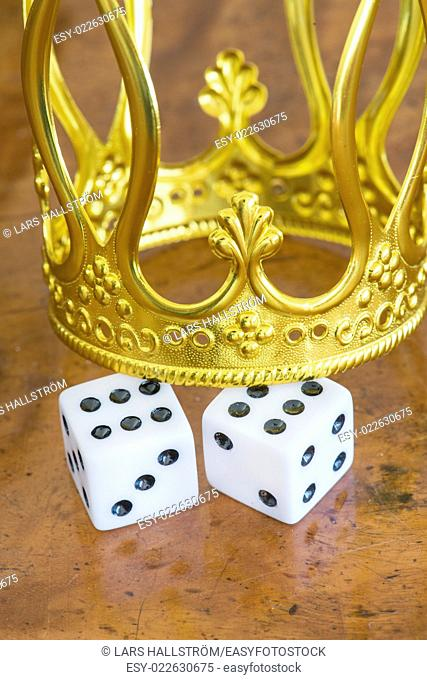 Golden crown and pair of dice. Concept of luck, success and fortune