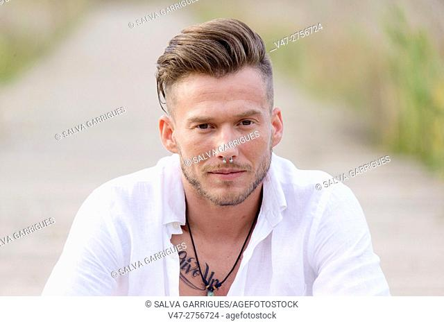 Portrait of a young man in the Natural Park of the Albufera, Valencia, Spain, Europe
