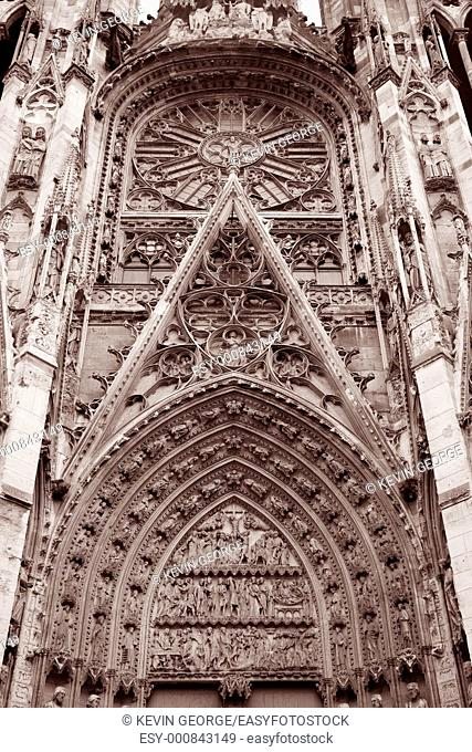 Detail on on one Entrance to Rouen Cathedral in Black and White Sepia Tone, Normandy, France