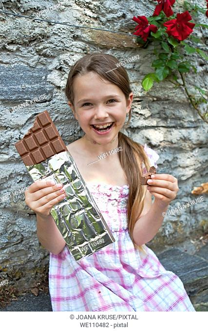 seven year old girl eats chocolate