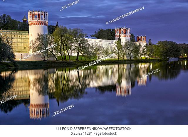 Outer wall of the Novodevichy Convent illuminated at dusk. Moscow, Russia