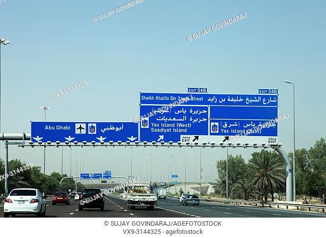 Abu Dhabi, UAE - June 06, 2012: Traffic moves along the Dubai-Abu Dhabi highway. In view is the 6 lane cariageway to Abu Dhabi