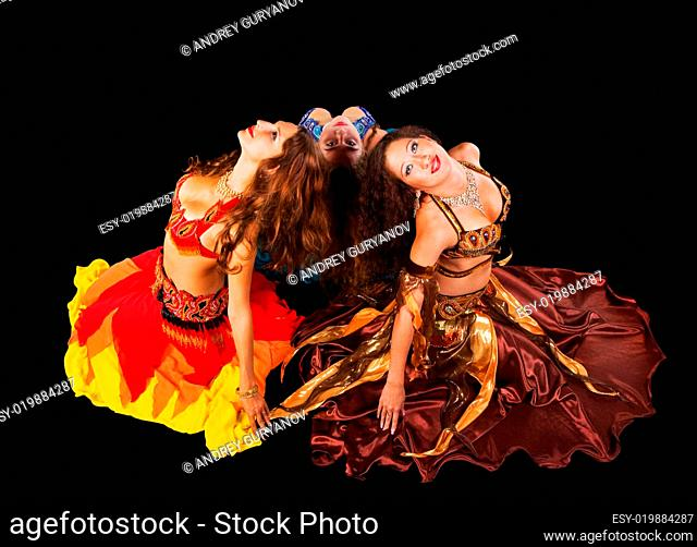 Three young woman in arabic costume